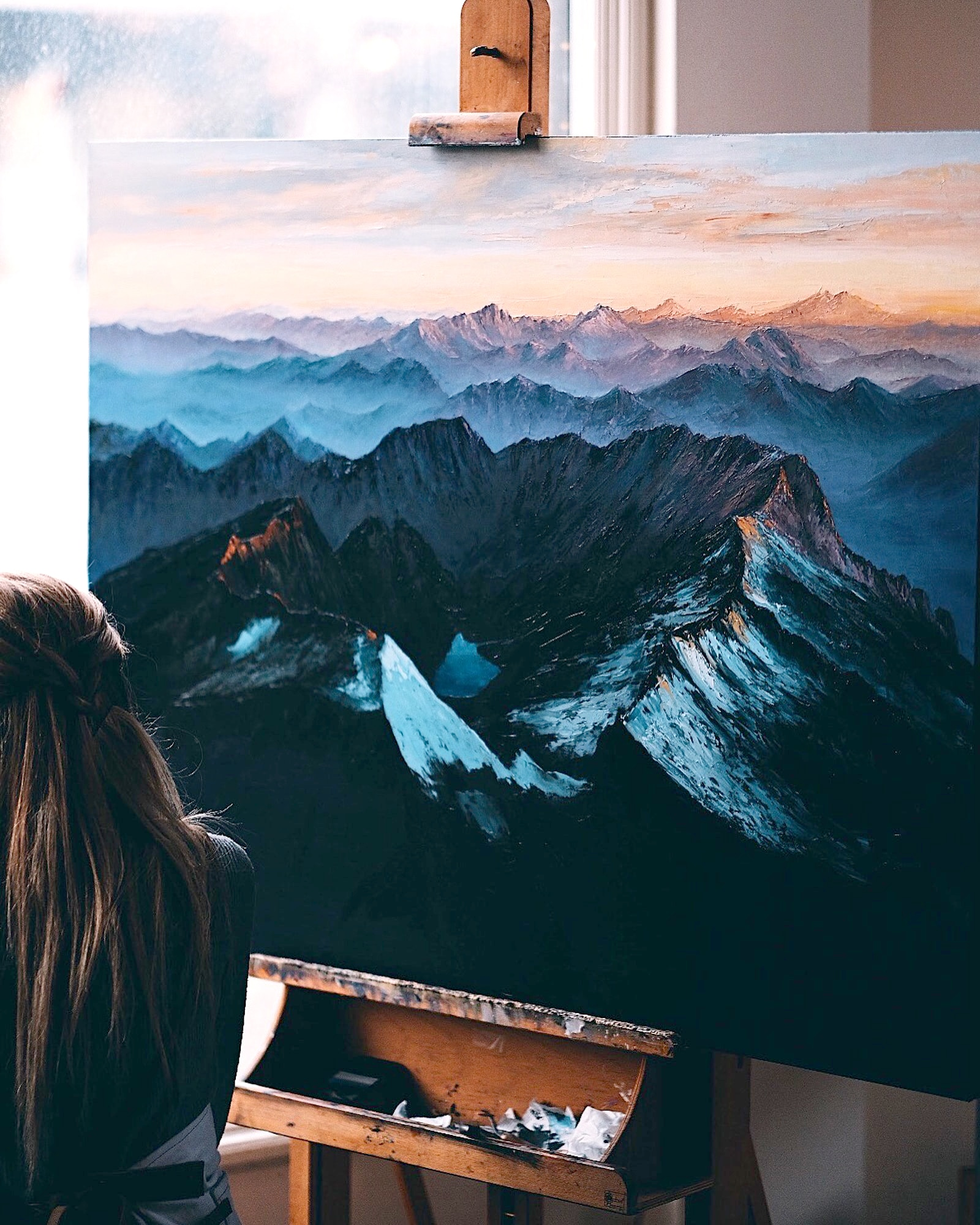 Detail shot of Northern Cascades painting with artist Elina in photo
